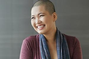 asian woman with short hair talking about being newly diagnosed