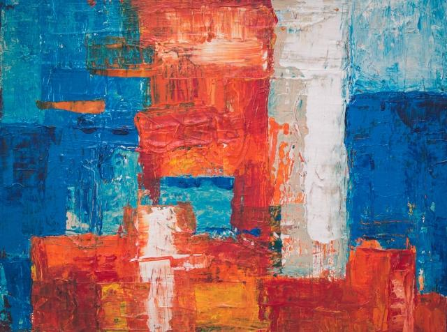 abstract artwork with red, orange, blue, and white paint
