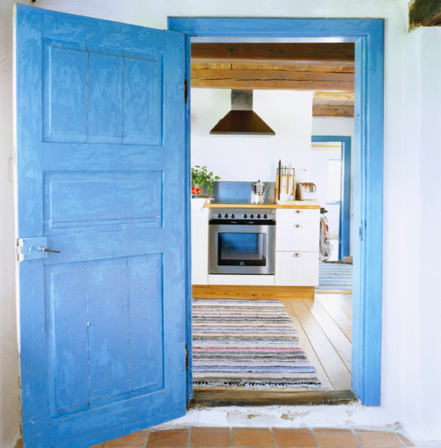 kitchen beyond blue door
