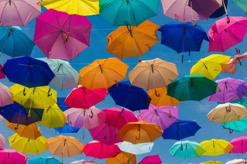Colorful umbrellas strung up in the sky
